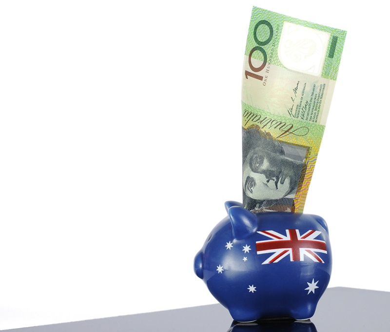 Australian money one hundred dollar note in red white and blue piggy bank with Australian flag for 30th June End of Financial Year Australian economy or savings concept.