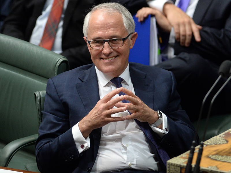 Australian Prime Minister Malcolm Turnbull (centre) reacts during Question Time in the House of Representatives at Parliament House in Canberra, Tuesday, Sept. 15, 2015. Turnbull was sworn in this afternoon after winning the Australian Federal Leadership in a party ballot vote. (AAP Image/Sam Mooy) NO ARCHIVING